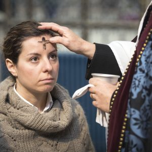 A worshiper receives the sign of the cross marked in ash on her forehead, from the Reverend Canon Dr Christopher Collingwood, during the Imposition of Ashes at York Minster on Ash Wednesday.